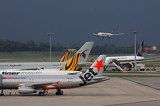 Jetstar Asia will beef up its fleet and fly twice daily to Phuket, while Tiger Airways says it will announce more good deals soon. -- ST FILE PHOTO