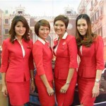 Thai AirAsia flight crew pose for a group photo at the fair.